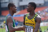 DONETSK, UKRAINE - JULY 14: O'Hara, Jamaica (right) accept congratulations from dos Santos, Brazil after final in 200 m during 8th IAAF World Youth Championships in Donetsk, Ukraine on July 14, 2013
