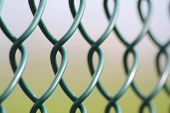 stock photo of stockade  - Green pattern from metal to make safety - JPG
