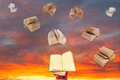 Book Above Of Stack Of Books And Sunset Sky