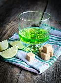 image of absinthe  - Glass of absinthe with lime and sugar cubes - JPG