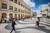 MACAU, CHINA - MAY 21, 2014: Pedestrians stroll down Senado Square. The territory was the last Europ