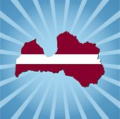 Latvia map flag on blue sunburst vector illustration