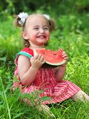 little girl eats watermelon with pleasure