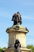 stock photo of william shakespeare  - Statue of William Shakespeare sitting on top of the Gower Memorial with Lady Macbeth in the foreground Stratford - JPG
