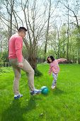 Asian Family Playing Football