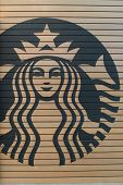 KUALA LUMPUR, MALAYSIA-MAY 06: Starbucks Cafe logo on May 06, 2014 in Kuala Lumpur, Malaysia. Starbucks Corporation is an American global coffee company and coffeehouse chain based in Seattle