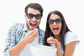 Attractive young couple watching a 3d movie on white background