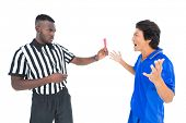 Serious referee showing red card to player on white background