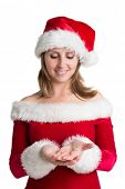 Pretty woman in santa costume presenting your product over white background