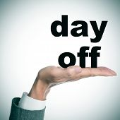 the hand of a man wearing a suit holding the text day off