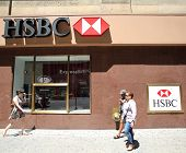 NEW YORK CITY - FRIDAY, JUNE 20, 2014:   Pedestrians walk past a HSBC bank in Manhattan on Friday, J