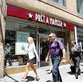 NEW YORK CITY - FRIDAY, JUNE 20, 2014:   Pedestrians walk past a Pret A Manger coffee and sandwich s