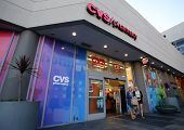 HOLLYWOOD, CALIFORNIA - TUES. JUNE 24, 2014: Pedestrians walk past a CVS drug store in Hollywood, Ca
