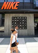 SANTA MONICA, CALIFORNIA - TUES. JUNE 24, 2014: Shoppers walk past a Nike sports clothing store in S