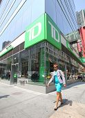 NEW YORK CITY - FRIDAY, JUNE 20, 2014:   Pedestrians walk past TD Bank, N.A. in New York City on Wed