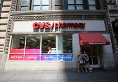NEW YORK CITY - FRIDAY, JUNE 20, 2014: Shoppers walk past a CVS drug store in New York City on Wedne
