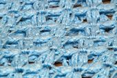 Angled Detail View Of Blue Crocheted Afghan Blanket