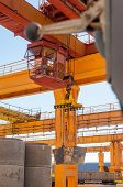 Crane operator works at finished goods warehouse