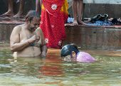 Having Fun During Ritual Bathing In The Ganges River.