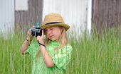 girl with fedora and camera