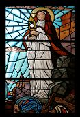 PORTOFERRAIO, ELBA, ITALY - MAY 03, 2014: Saint Clare of Assisi stained glass in the Church of the Holy Sacrament in Portoferraio, Island of Elba, Tuscany, Italy on May 03, 2014