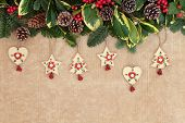 Christmas  background border with old fashioned wooden decorations, fir, holly, ivy, mistletoe and p