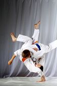 picture of judo  - In judogi two athletes doing judo throws - JPG