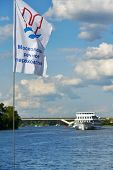 MOSCOW, RUSSIA - JULY 4, 2014: Flag of Moscow River Shipping Company against the ship on the Moscow