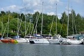 DOLGOPRUDNY, MOSCOW REGION, RUSSIA - JULY 4, 2014: Yachts moored in the yacht club Neptune. Founded
