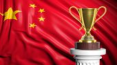 Golden trophy with Chinese flag in background