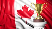Golden trophy with Canadian flag in background