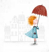 Cute red-head girl with umbrella in blue coat on city background.Wallpaper for girl's room for maga