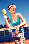 picture of youg  - Youg pretty girl playing tennis on cort - JPG