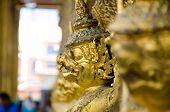 picture of garuda  - close up face of garuda decoration on chapel base at grand palace phrakaew temple Bangkok Thailand - JPG