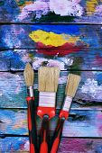 stock photo of bristle brush  - Photo of paint brushes on wooden background - JPG