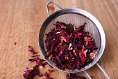 Hibiscus dried tea on wooden background
