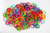 stock photo of loom  - colorful background rainbow colors rubber bands loom - JPG