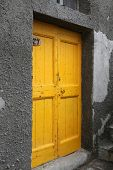 RIOMAGGIORE, ITALY - MAY 02, 2014: Brightly color door in Riomaggiore, one of the Cinque Terre villa