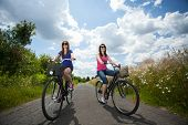 Girls On A Trip Riding Bicycles