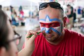 Man Gets Lafleur Symbol Painted On Face At Festival