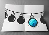 Hand Drawn Light Bulb On Wire Doodle With Crumpled Paper As Leadership Idea Concept
