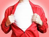 stock photo of open shirt breast showing  - Man pulling jacket showing white t - JPG