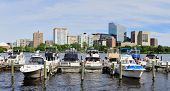 Boston skyline panorama over Charles River with boat and urban architecture.