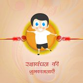 Happy cute little boy holding a big rakhi with wishes on occasion of Happy Raksha Bandhan celebratio