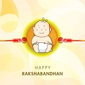 Cute little boy picture decorated rakhi on shiny yellow background for Happy Raksha Bandhan celebrat