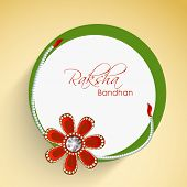 Beautiful sticky design decorated with flower on beige background for Happy Raksha Bandhan celebrati
