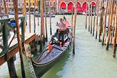 Gondolier In A Gondola On The Grand Canal In Venice, Italy