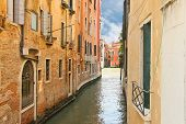 House On A Narrow Canal In Venice, Italy