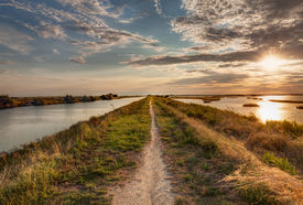 picture of marshlands  - panorama at sunset of the wetland a long straight path across the lagoon in the natural reserve  - JPG