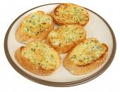 Garlic bread slices on a plate.